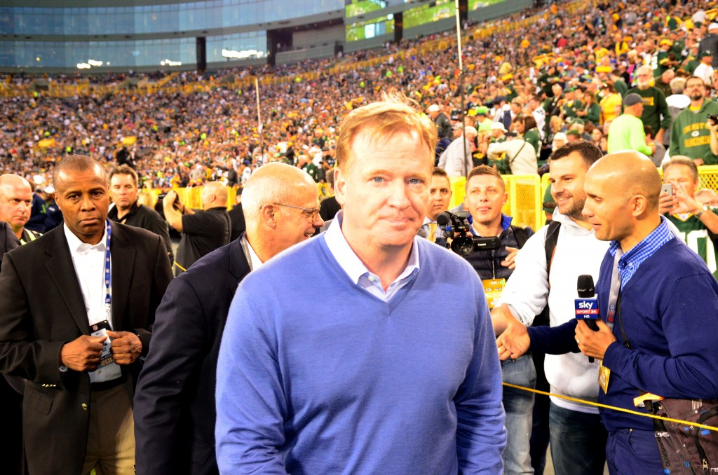 NFL Commisioner Roger Goodell heads for the tunnel after a quick interview before the Seattle game.
