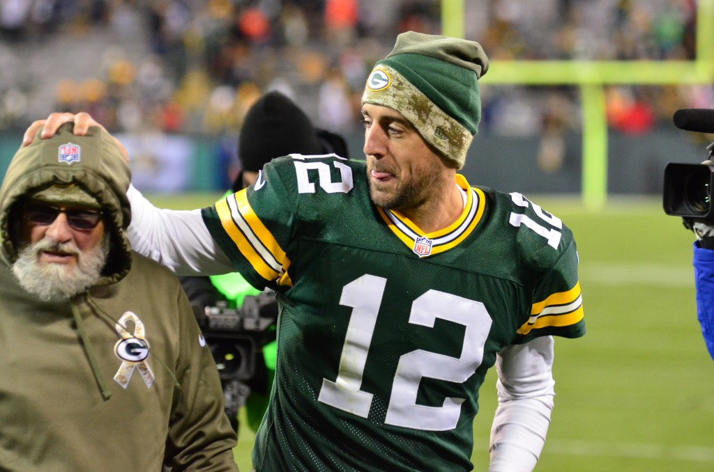 Aaron Rodgers playfully grabs a long-time staffer's head after a Lambeau victory.